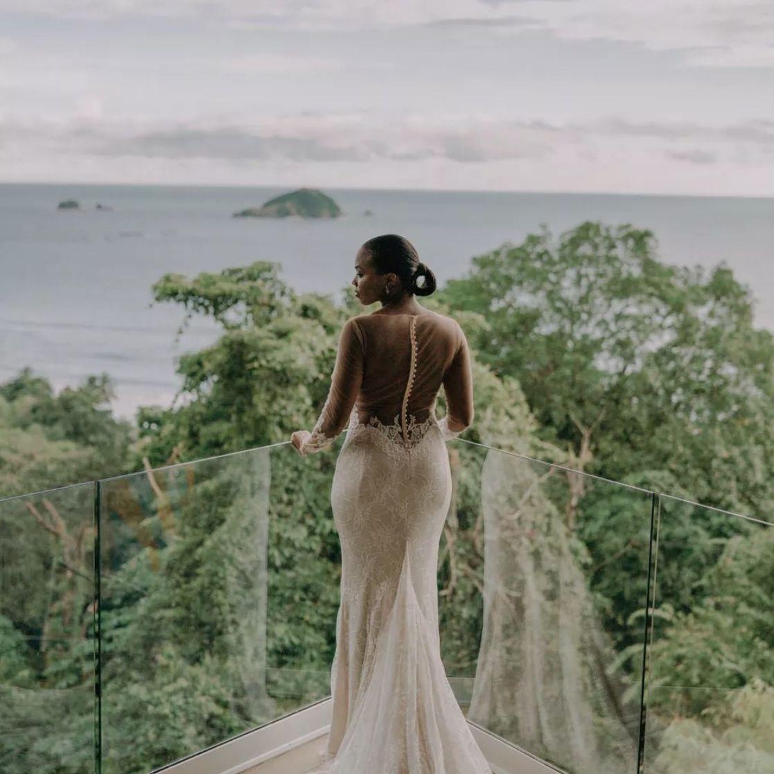 Bride looking out at ocean