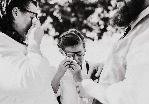 Emotional moment child bride and groom