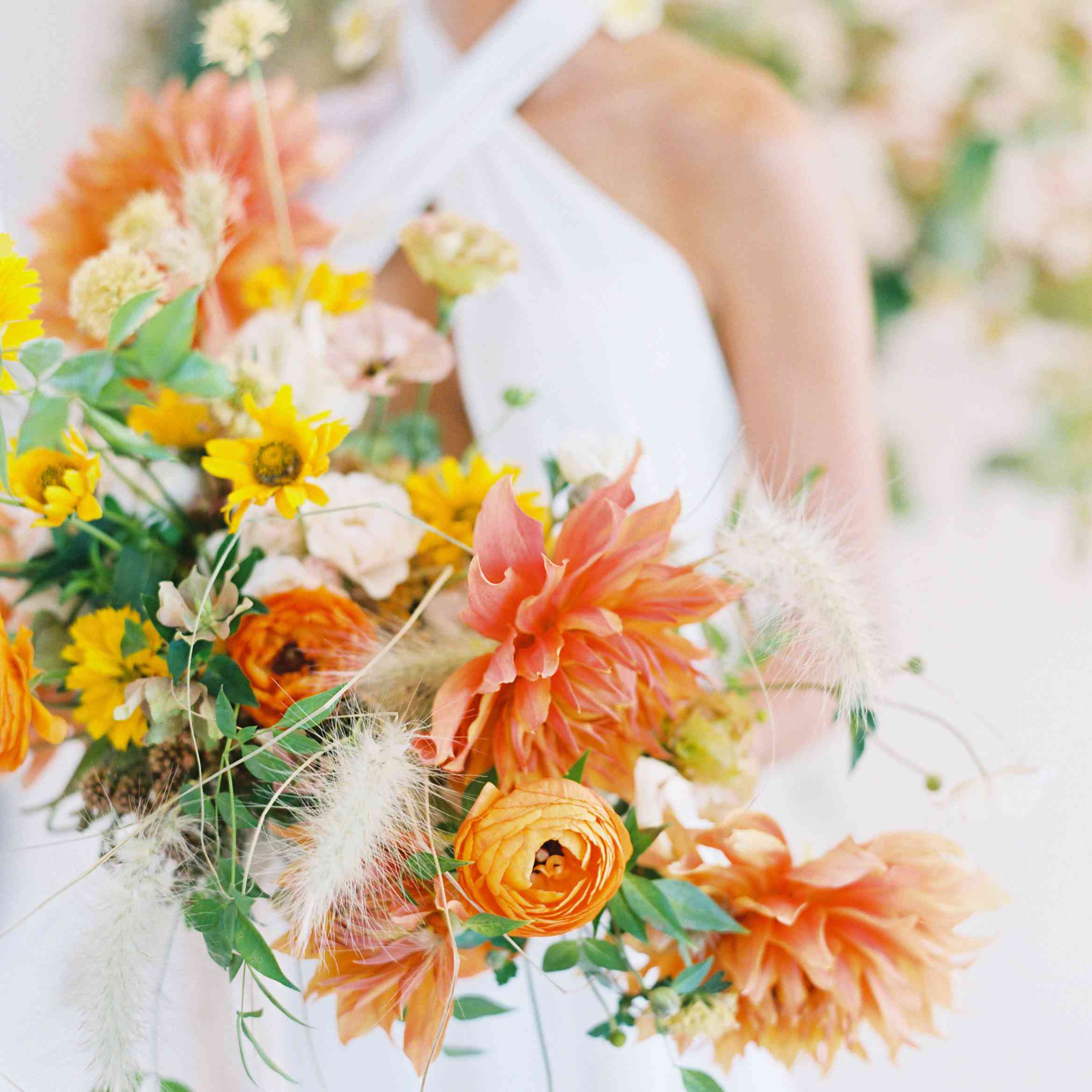 Fall bridal bouquet made up of ranunculus and dahlias