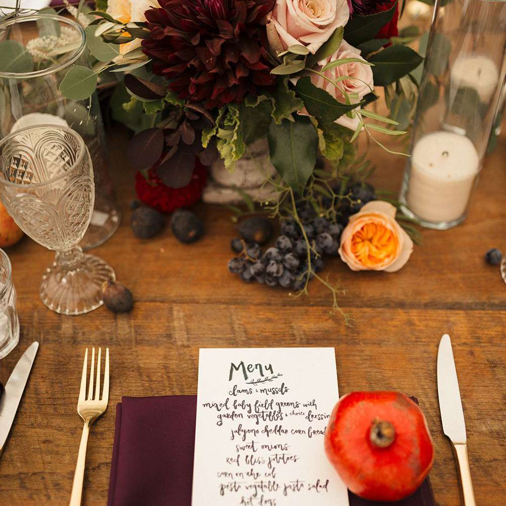 Menu featuring script placed on table with flowers