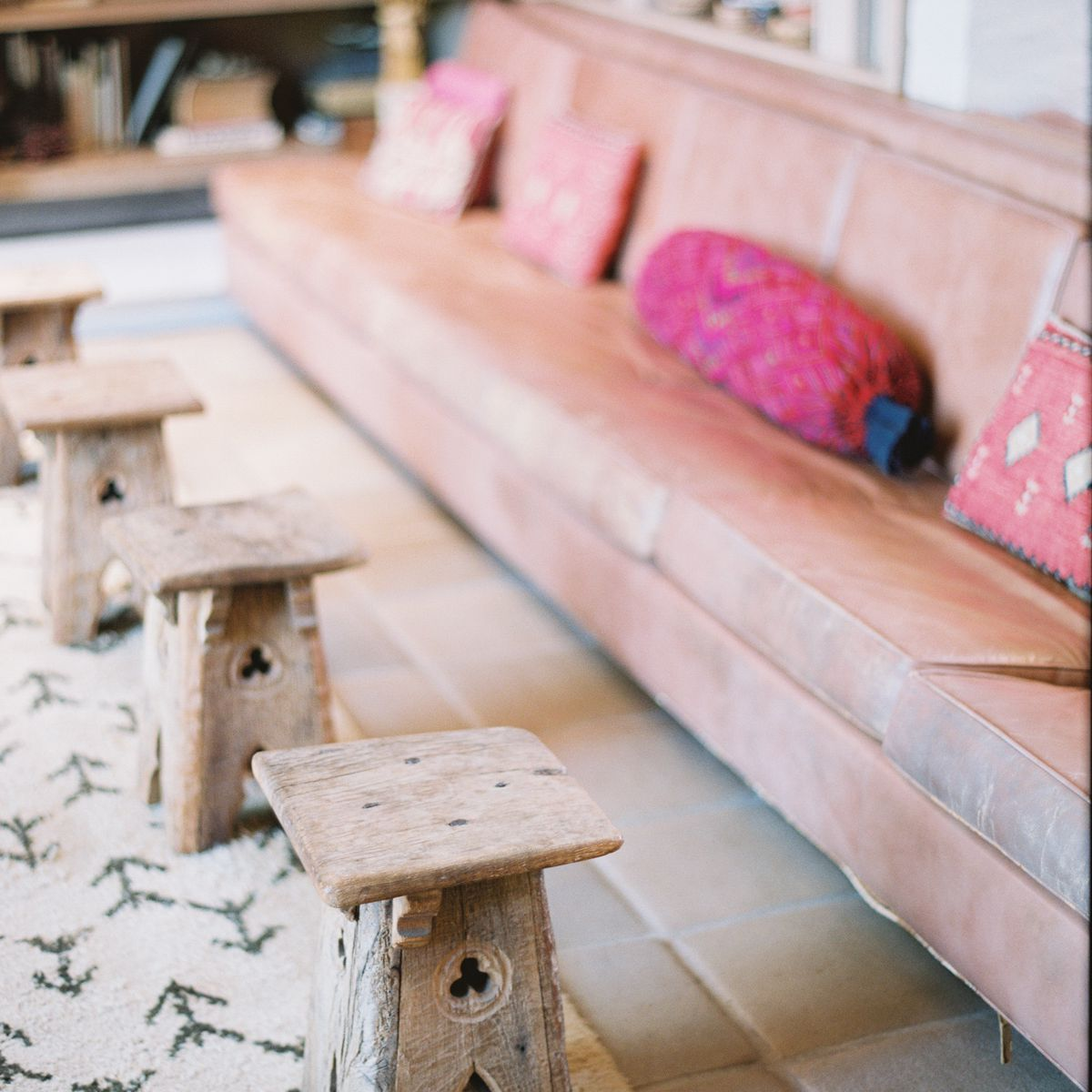 pink couch and wood decor