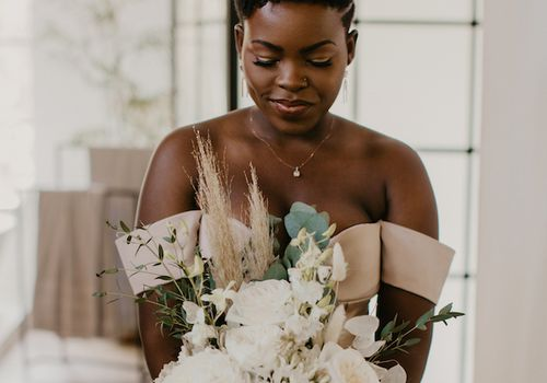 Bride with short hair holding a bouquet of flowers