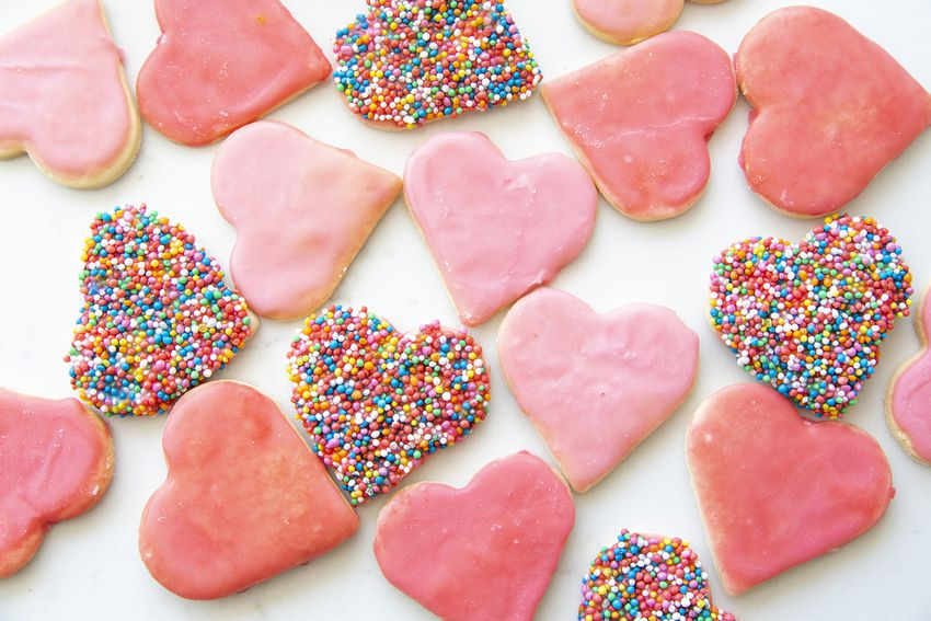 Sweet pink iced heart shaped biscuits with sprinkles