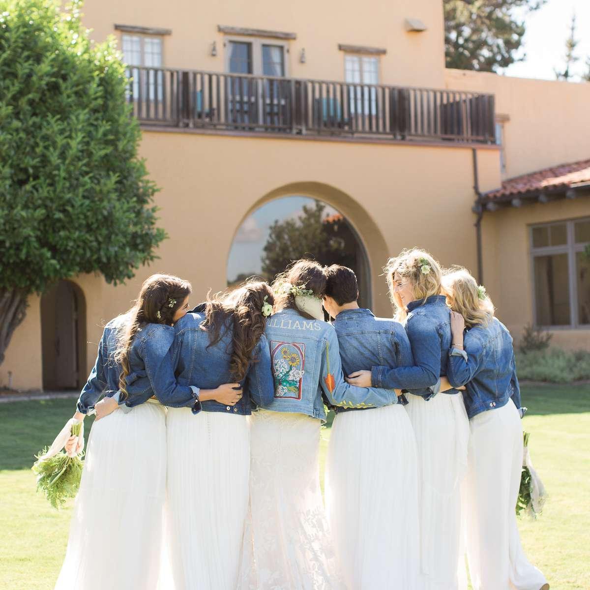 Bride with bridesmaids in jean jackets