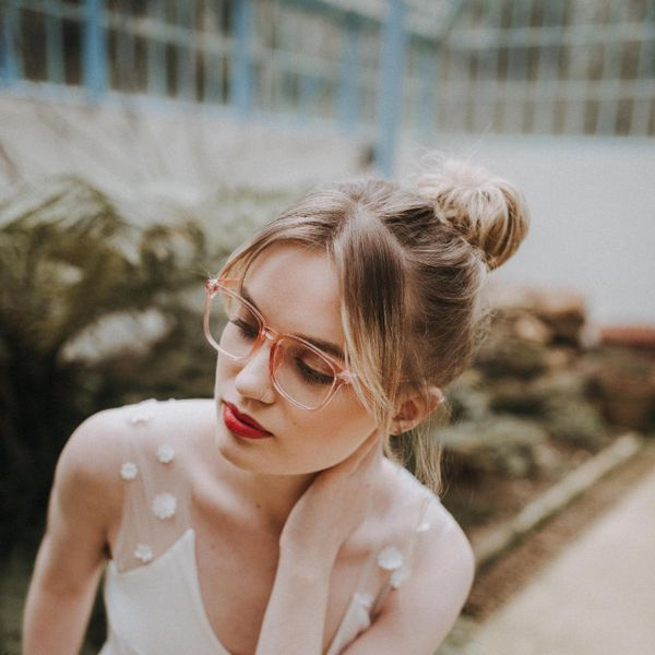 Bride with hair in bun wearing glasses