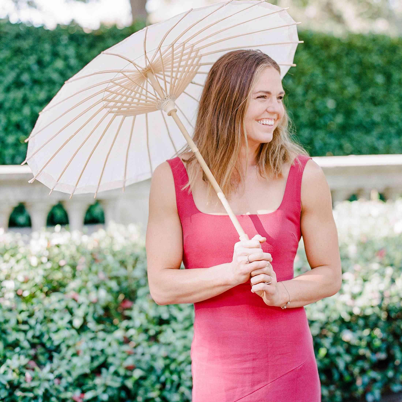 woman with sun umbrella at a wedding