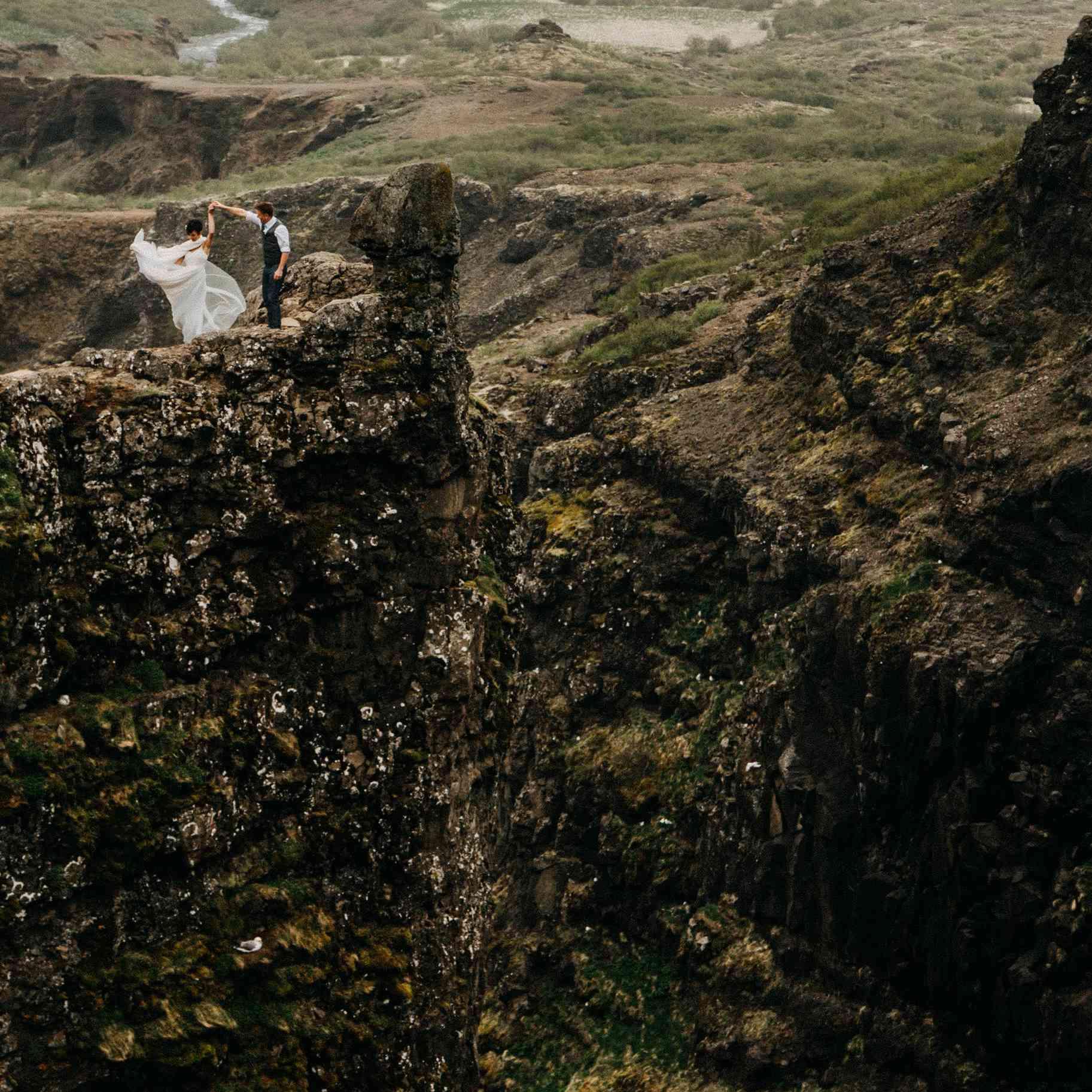 Couple dancing on Icelandic Cliffs
