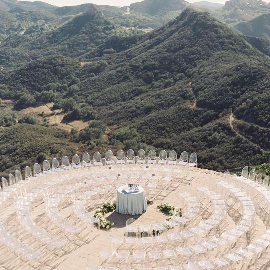 Wedding ceremony seats arranged in circular rows