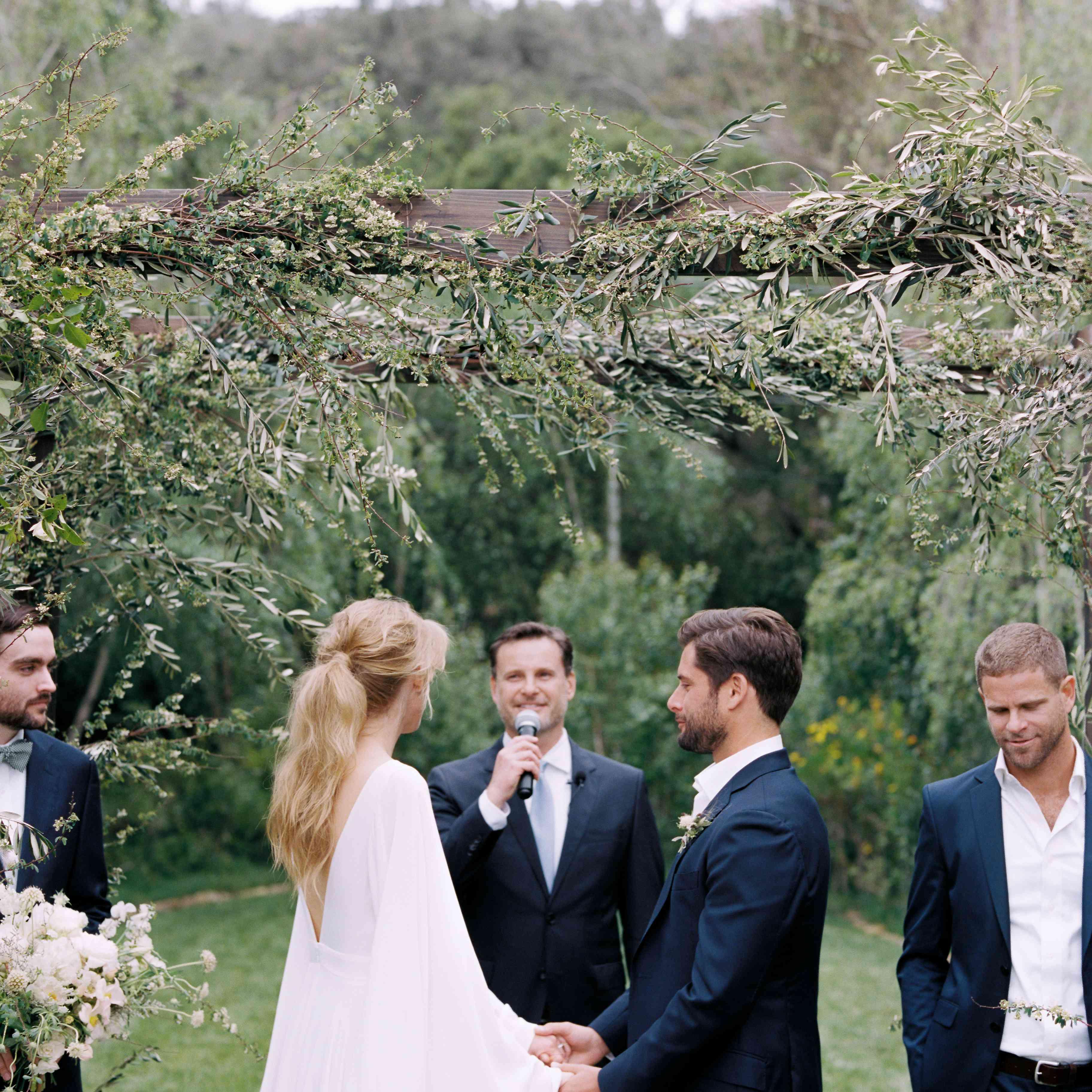 bride and groom holding hands wedding ceremony