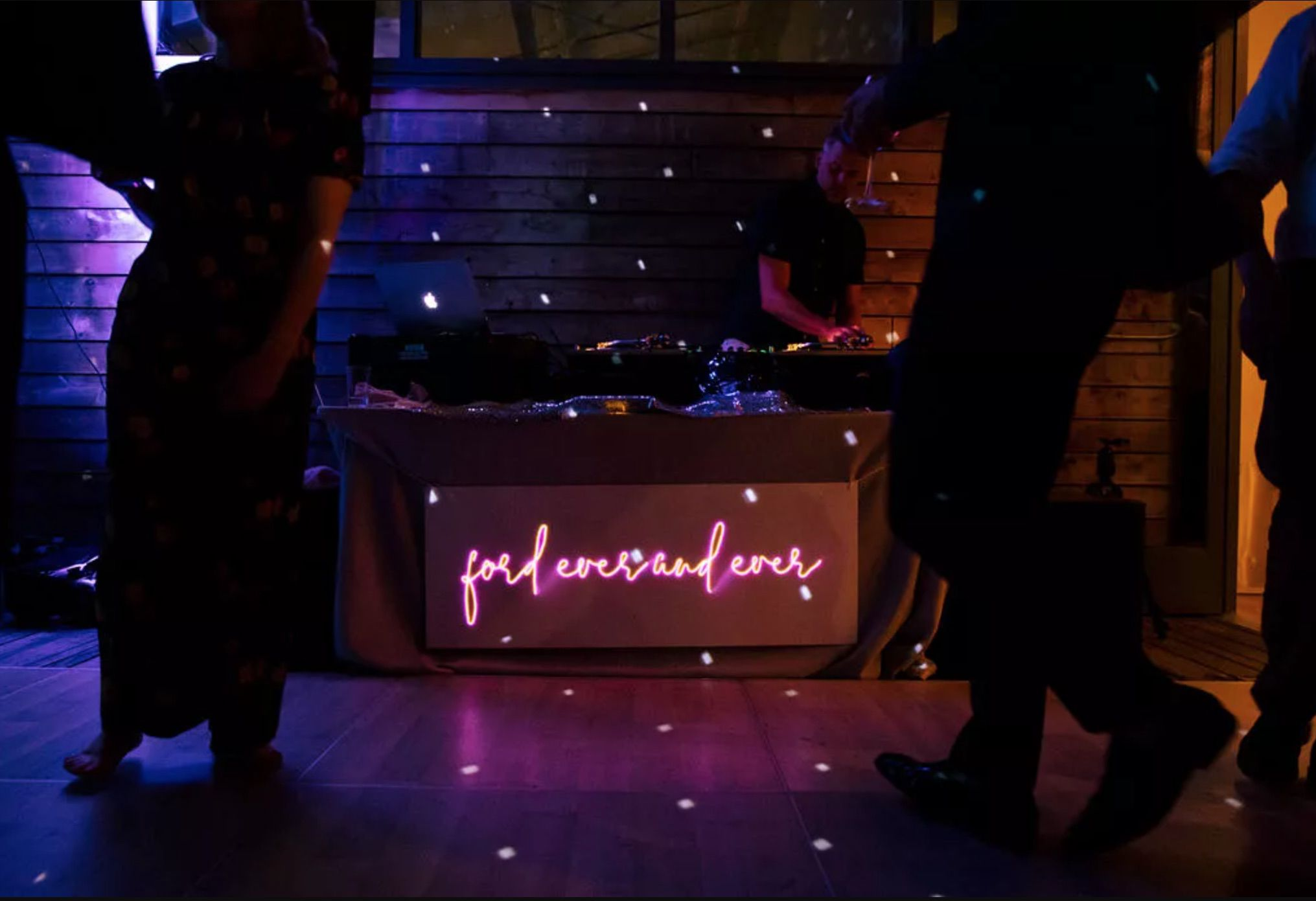 DJ booth with neon sign