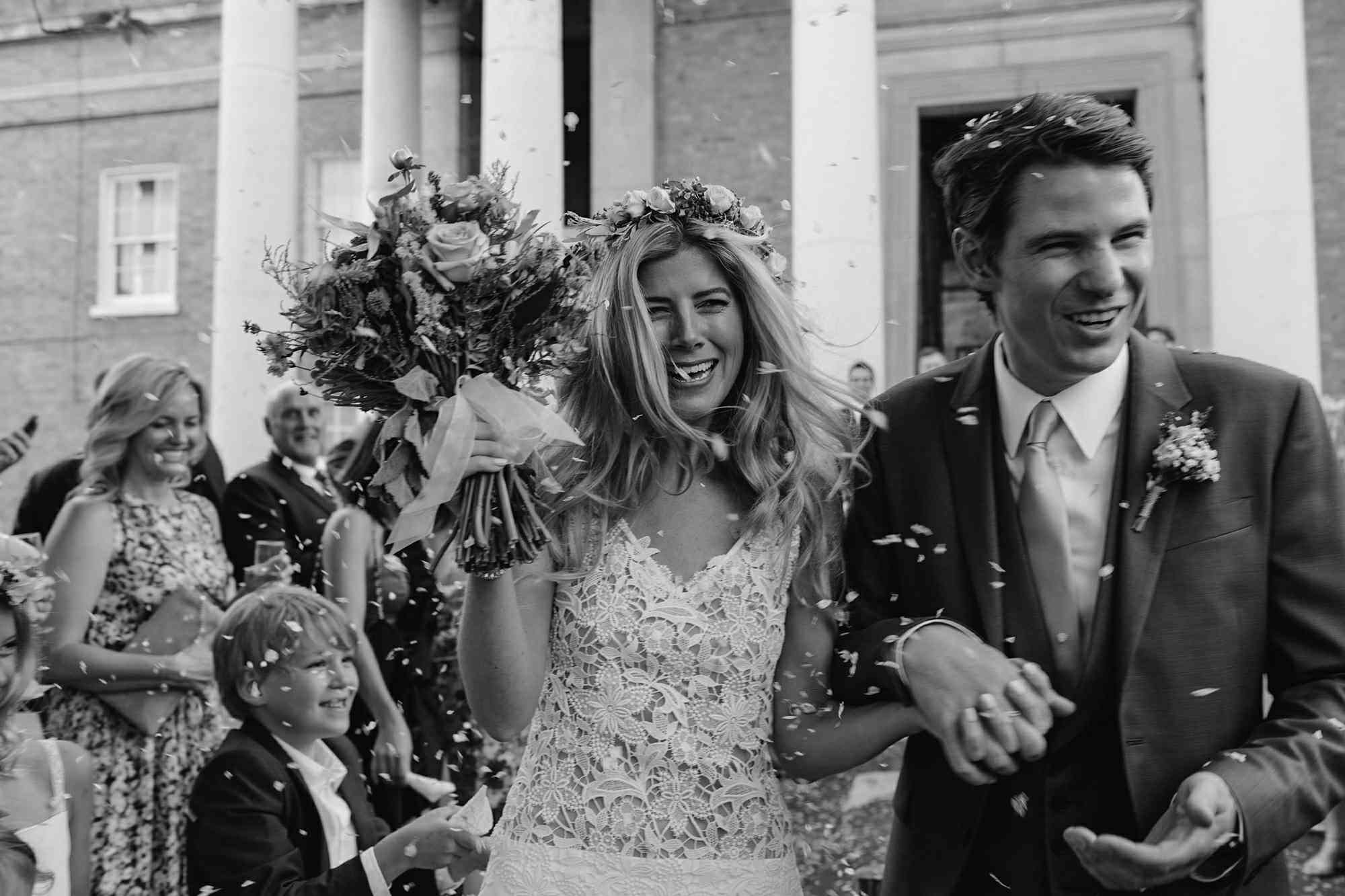Newlyweds holding bouquet