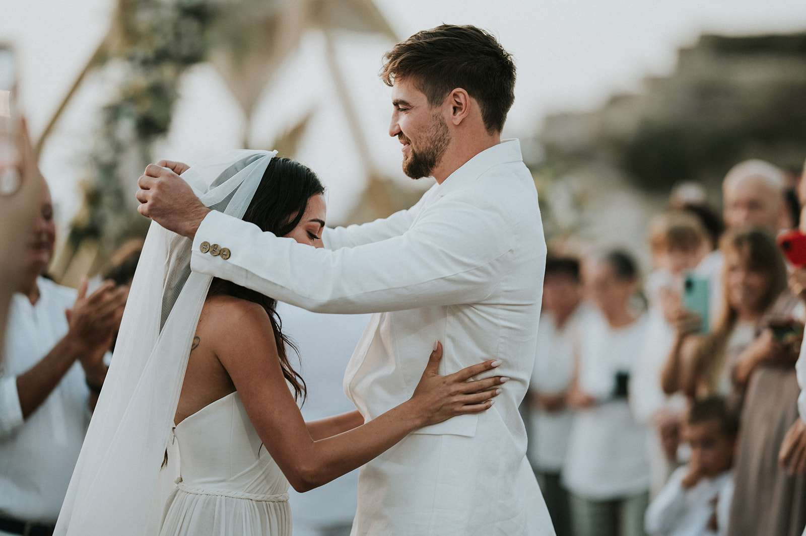 bride and groom veil lift