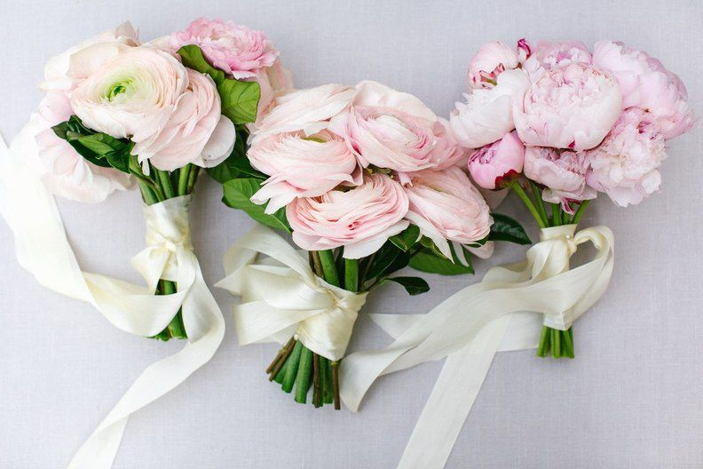 Three small bouquets of pink ranunculus and peonies