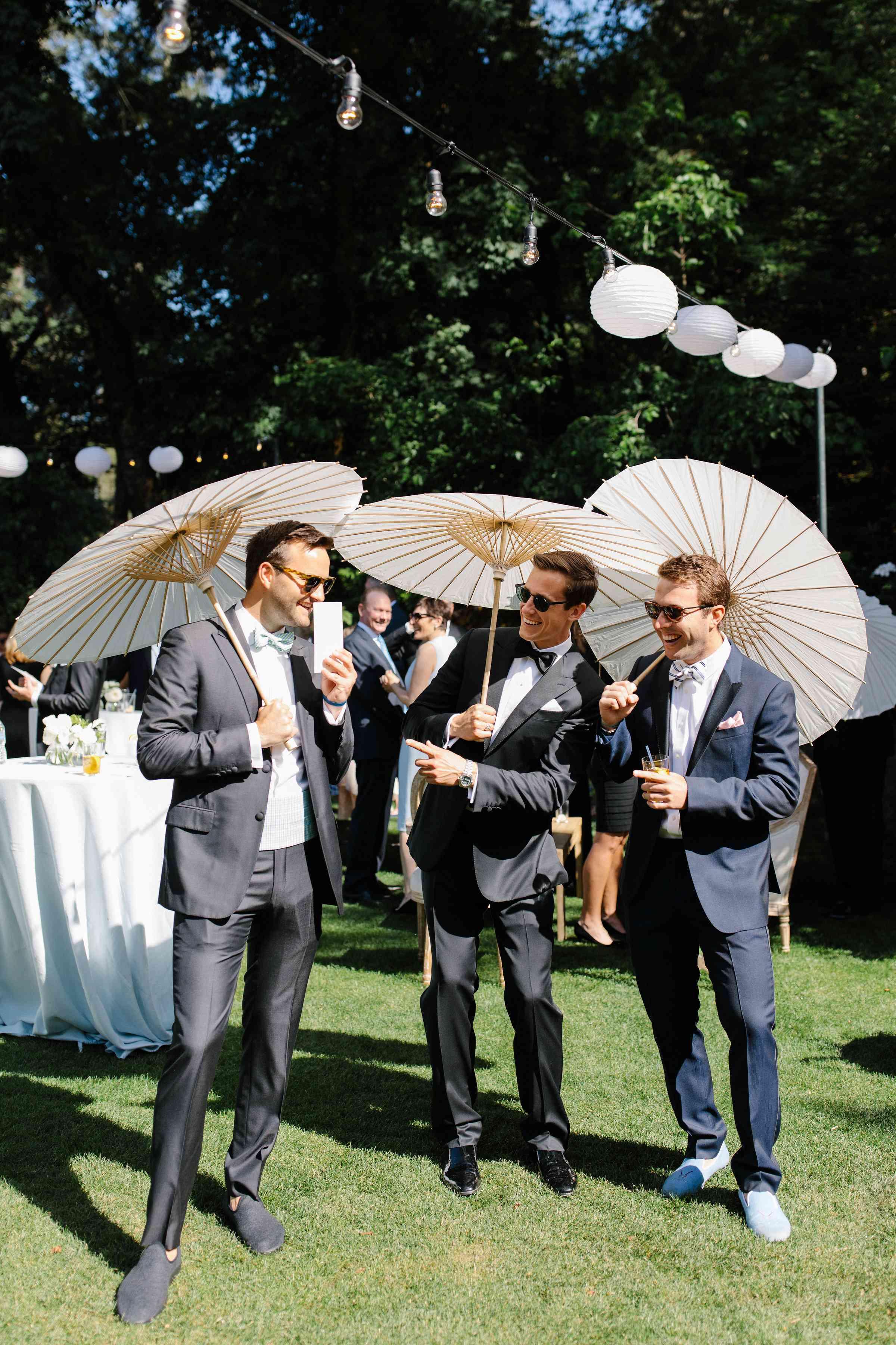 <p>wedding guests with parasols</p><br><br>