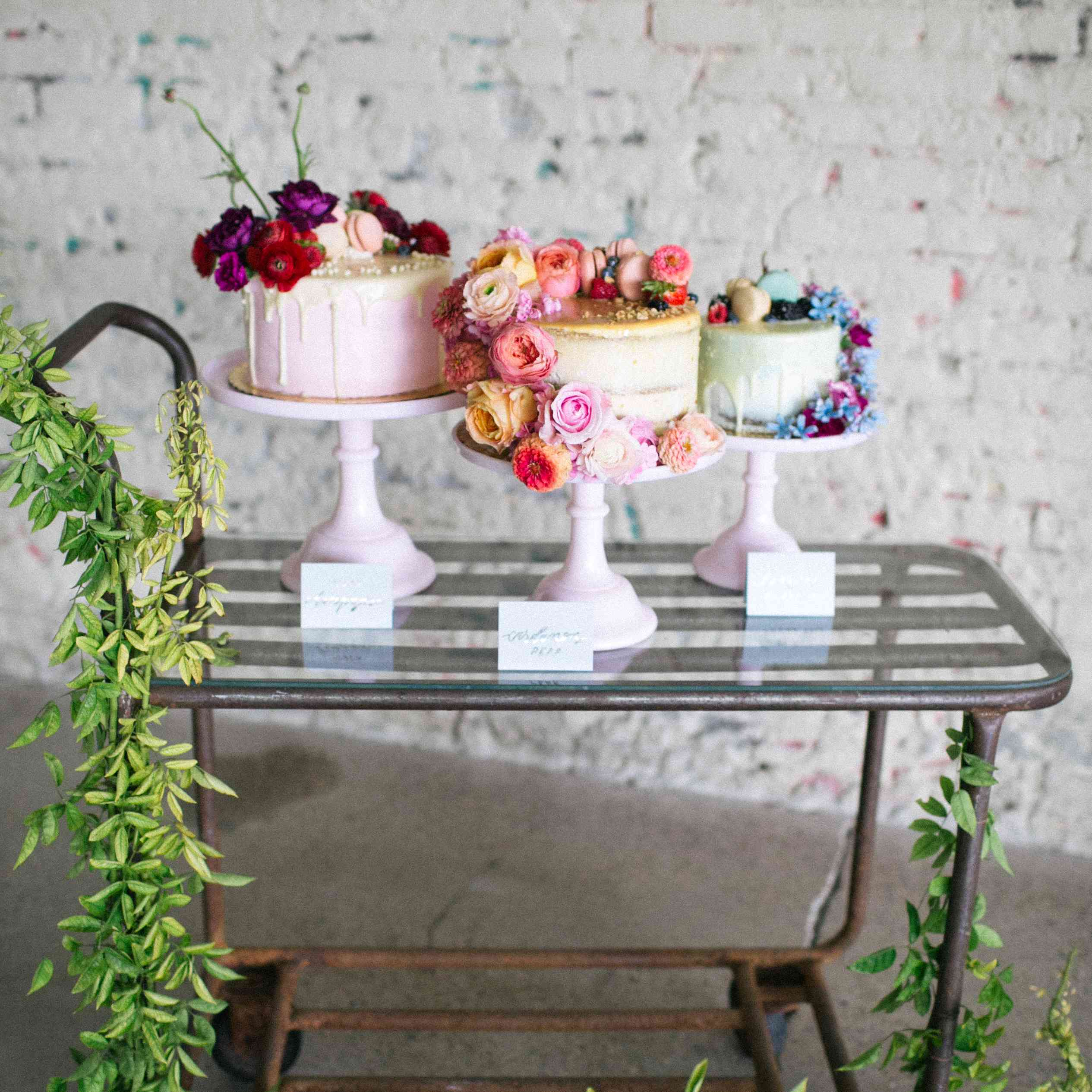 Three wedding cakes on a rolling cart