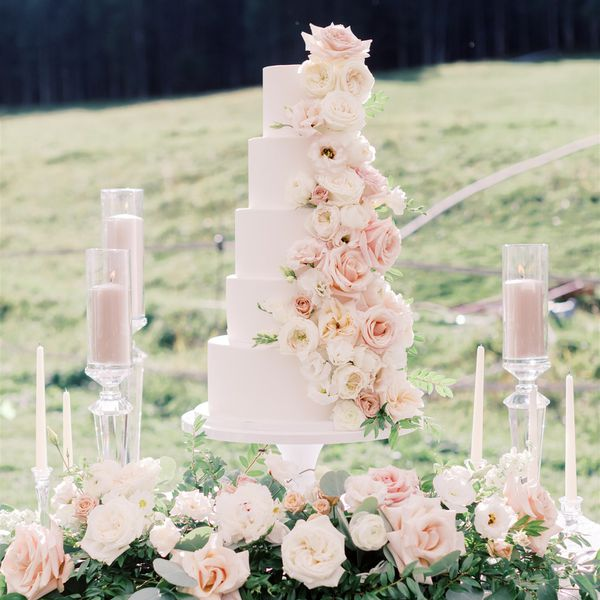 white cake with white and pink roses