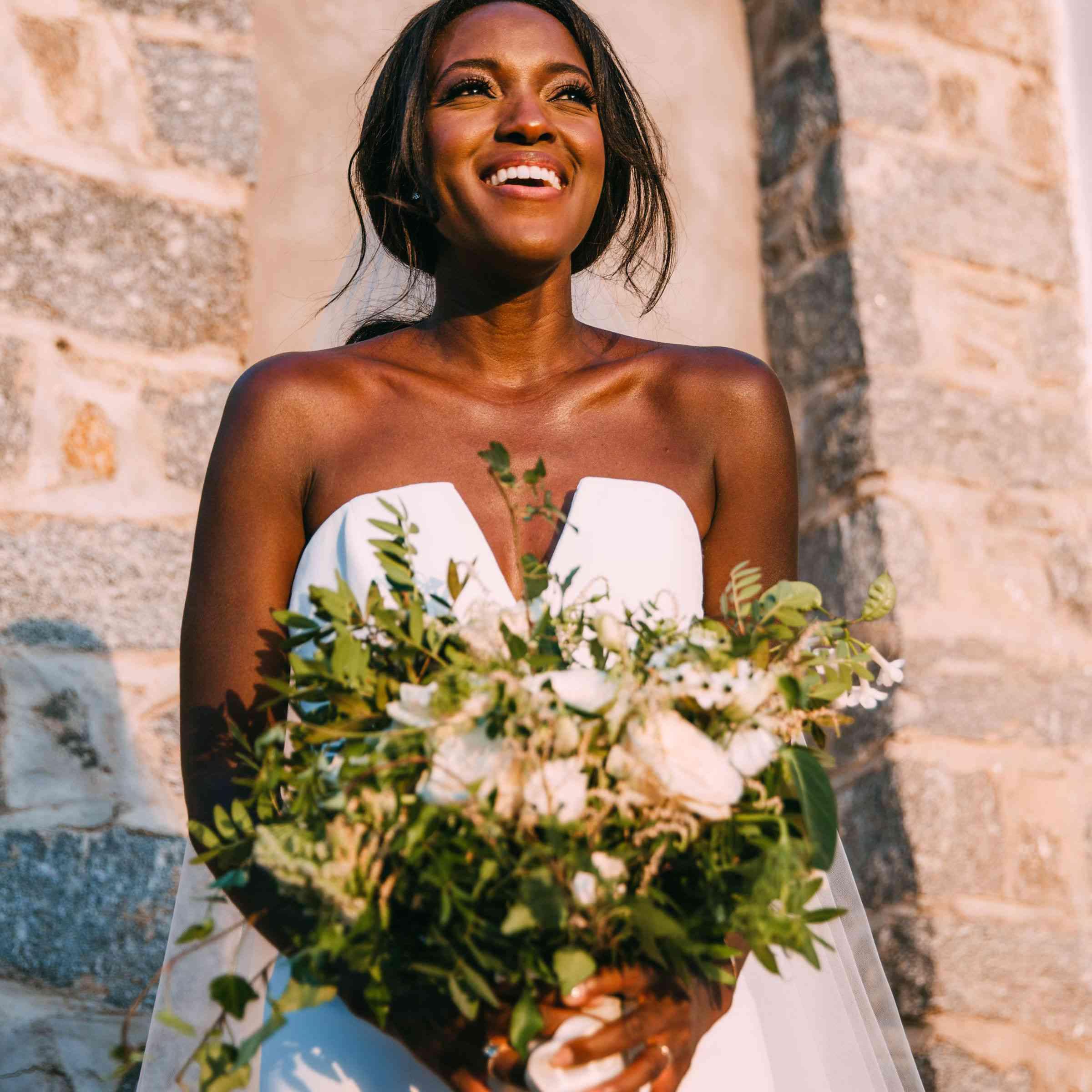 Bride smiling with floral bouquet