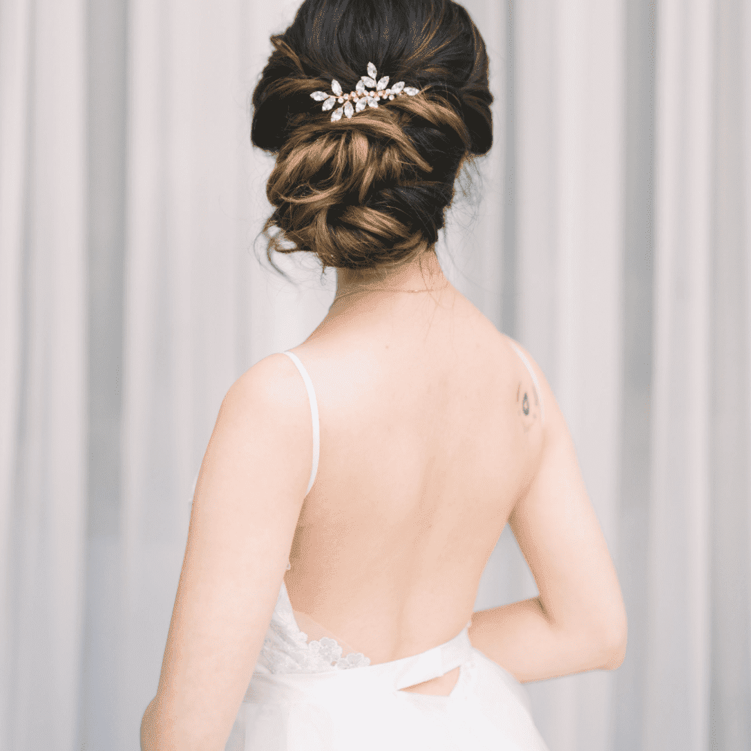 image of the back of a bride's head, showing her side bun