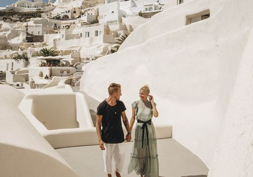 Man and woman walking in Greece