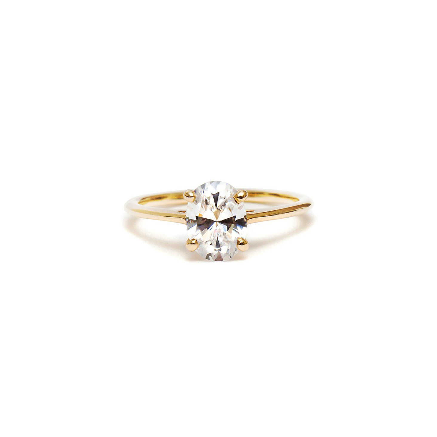 Diamond engagement ring with yellow gold band on a white background