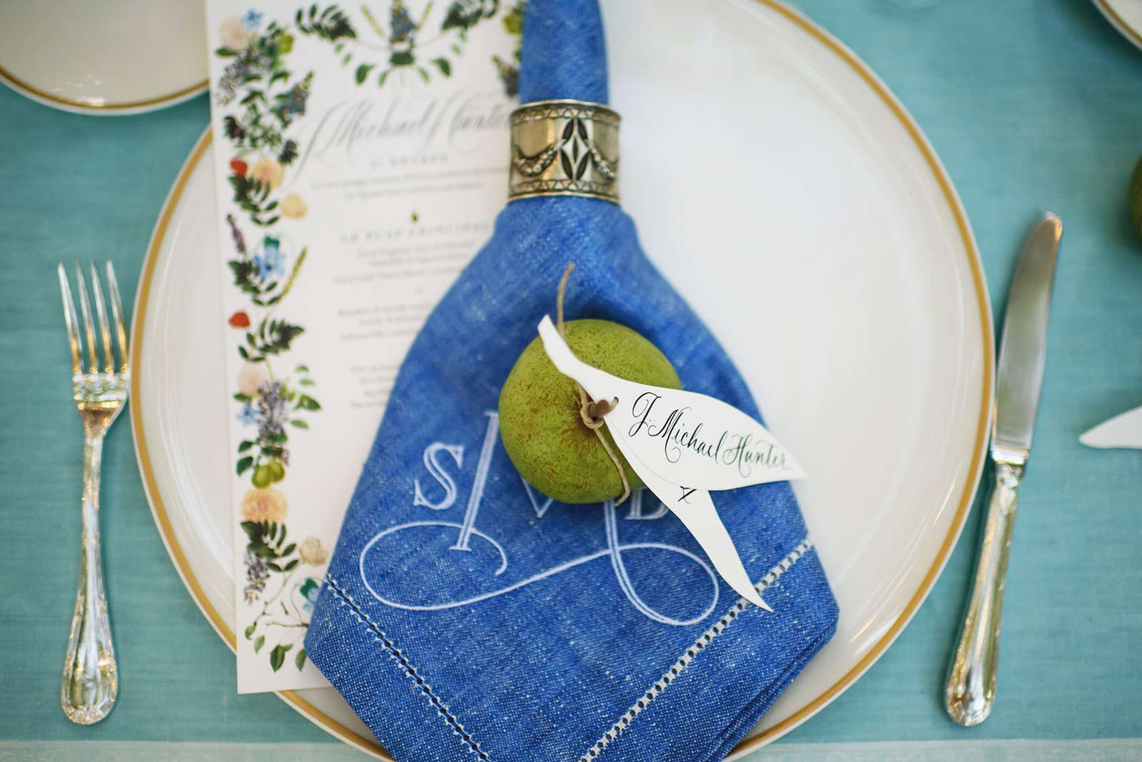 Pear at wedding place setting