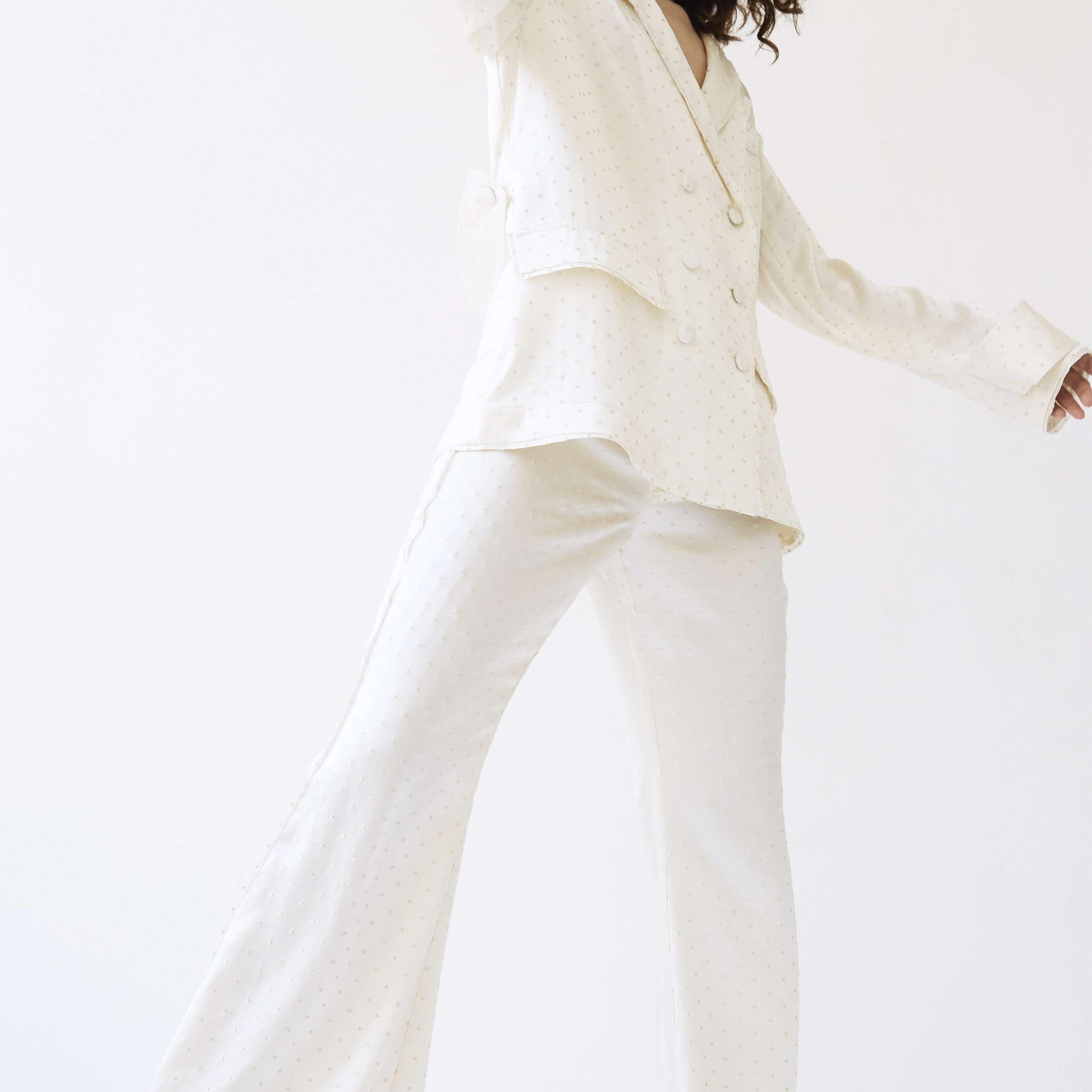Model in wedding blazer and wide leg pants