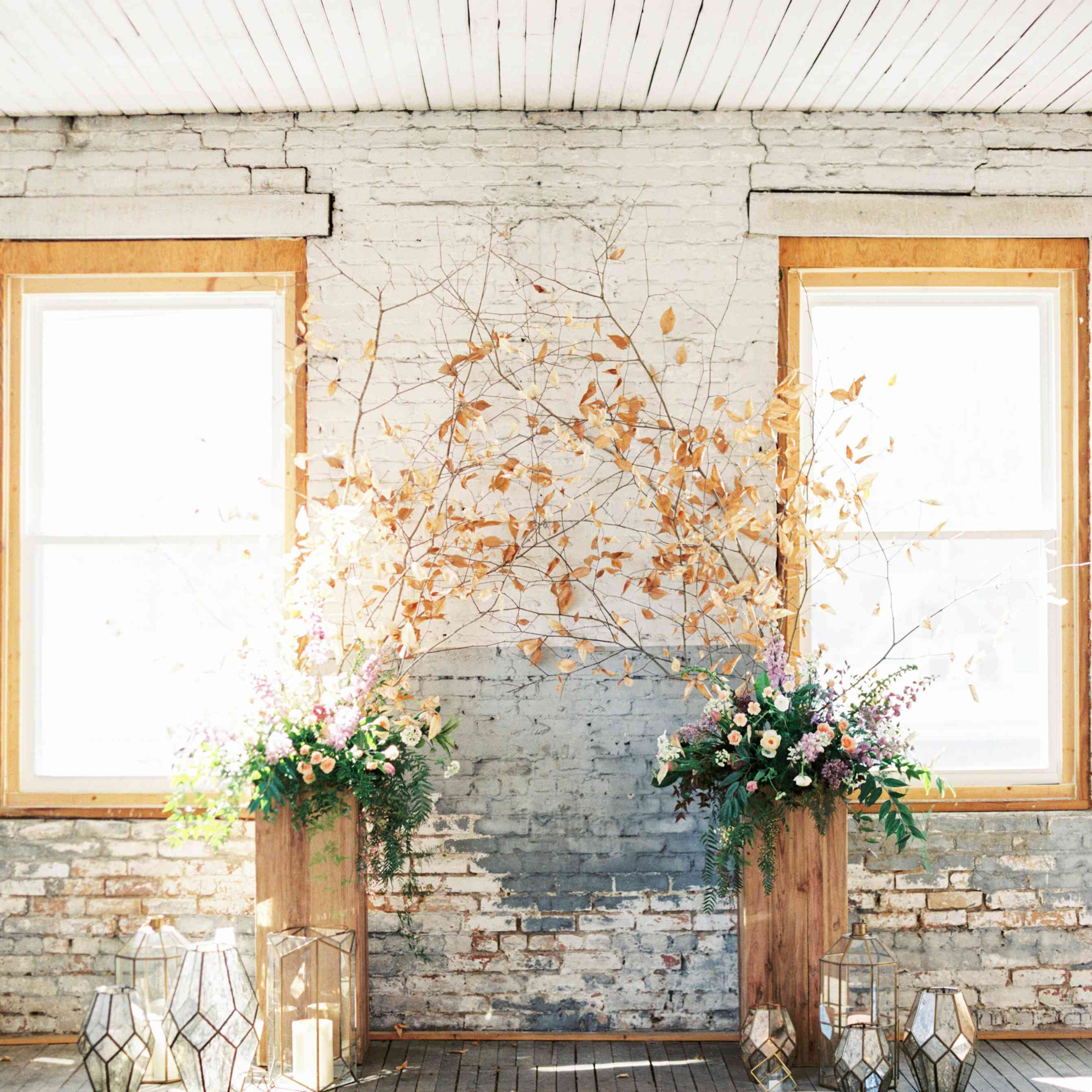 Floral and branch-inspired indoor wedding ceremony décor