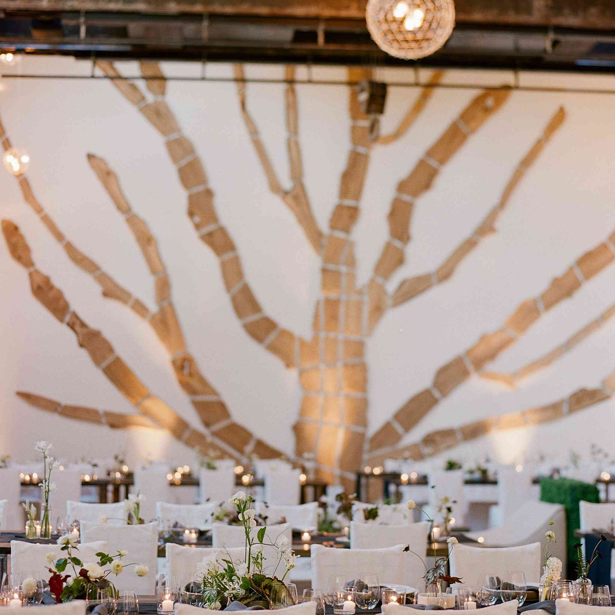 <p>long reception tables with votives and ikebana arrangements</p><br><br>