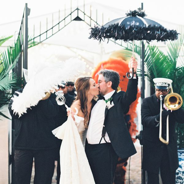 <p>new orleans wedding parade bride and groom</p>