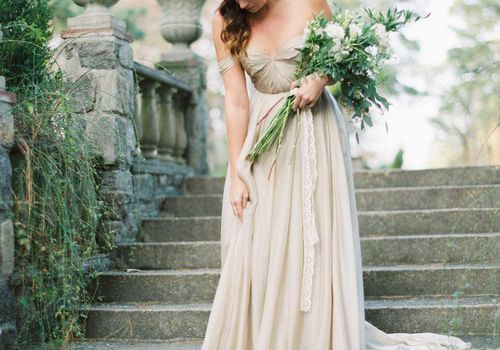 <p>Bride in Off-the-Shoulder Wedding Dress with Long-Stemmed Bouquet</p>