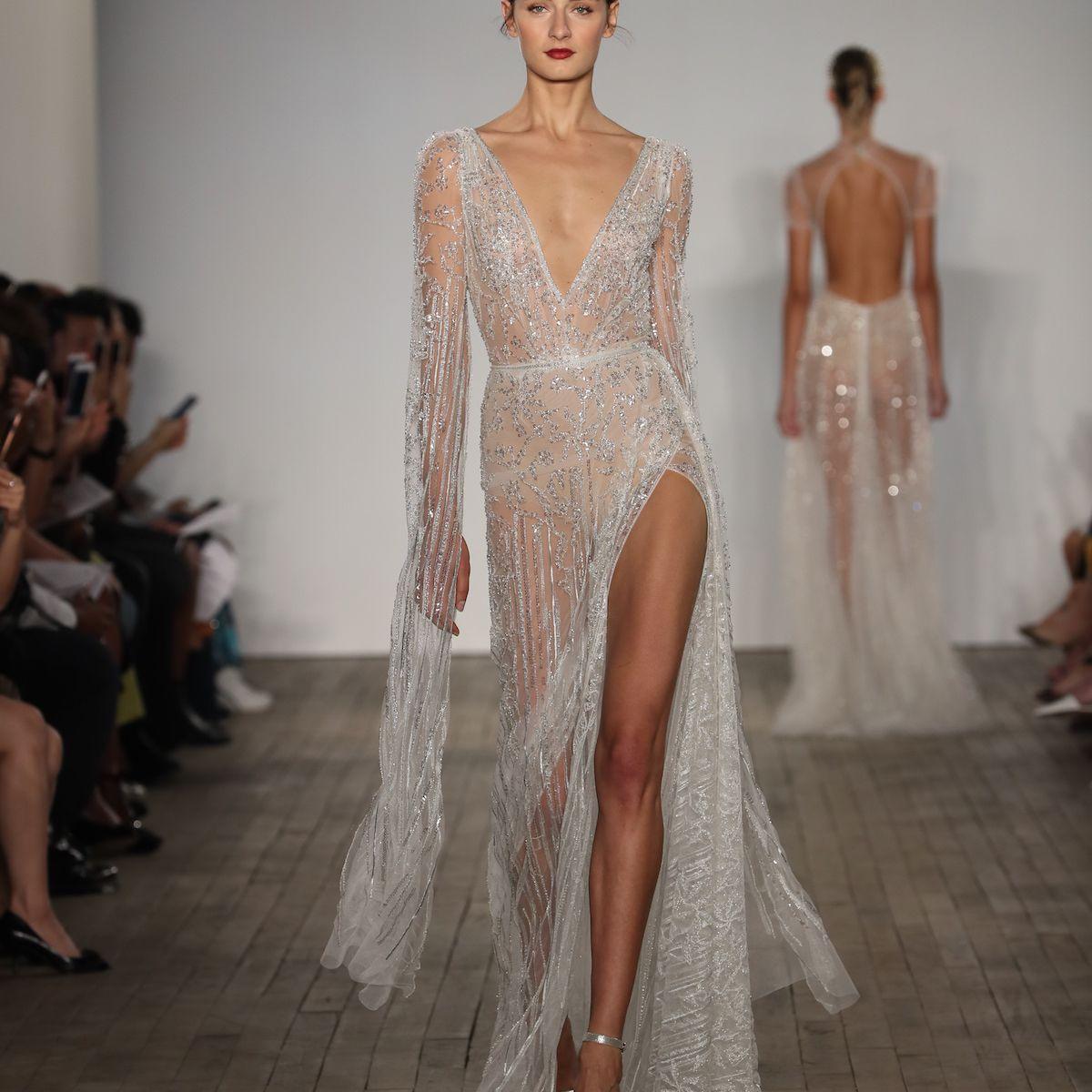 Model in long sleeve deep V-cut wedding dress