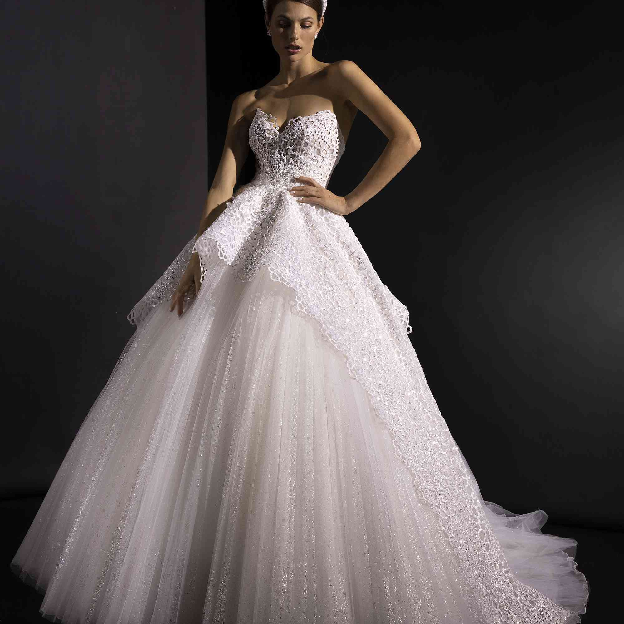 Model in strapless ballgown with tulle skirt and lacy bodice
