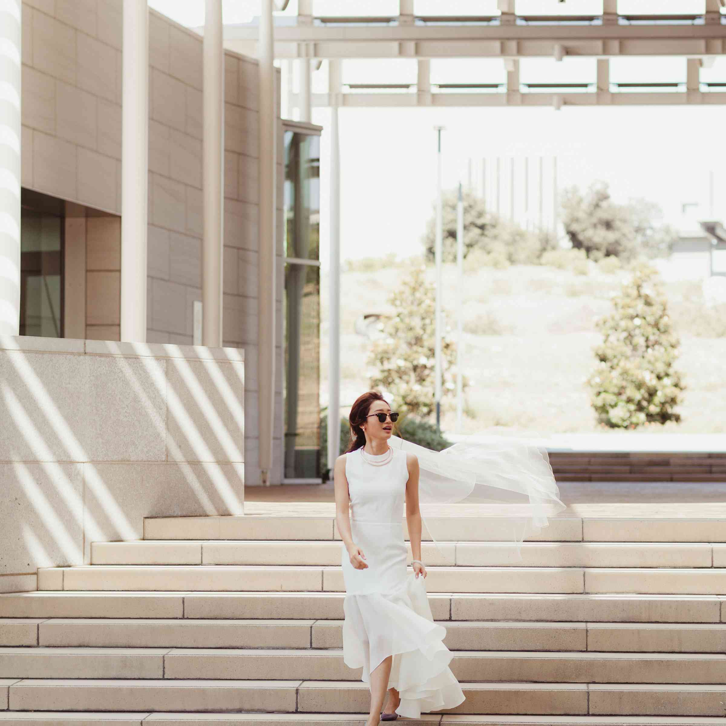 Bride in sunglasses on stairs