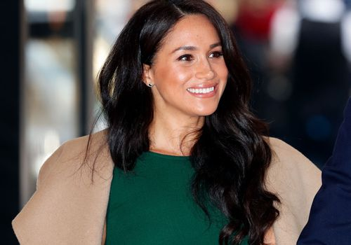 Meghan Markle wears a green dress in London.