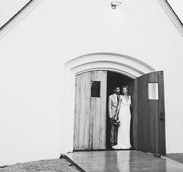 Couple during wedding in chapel on a rainy day