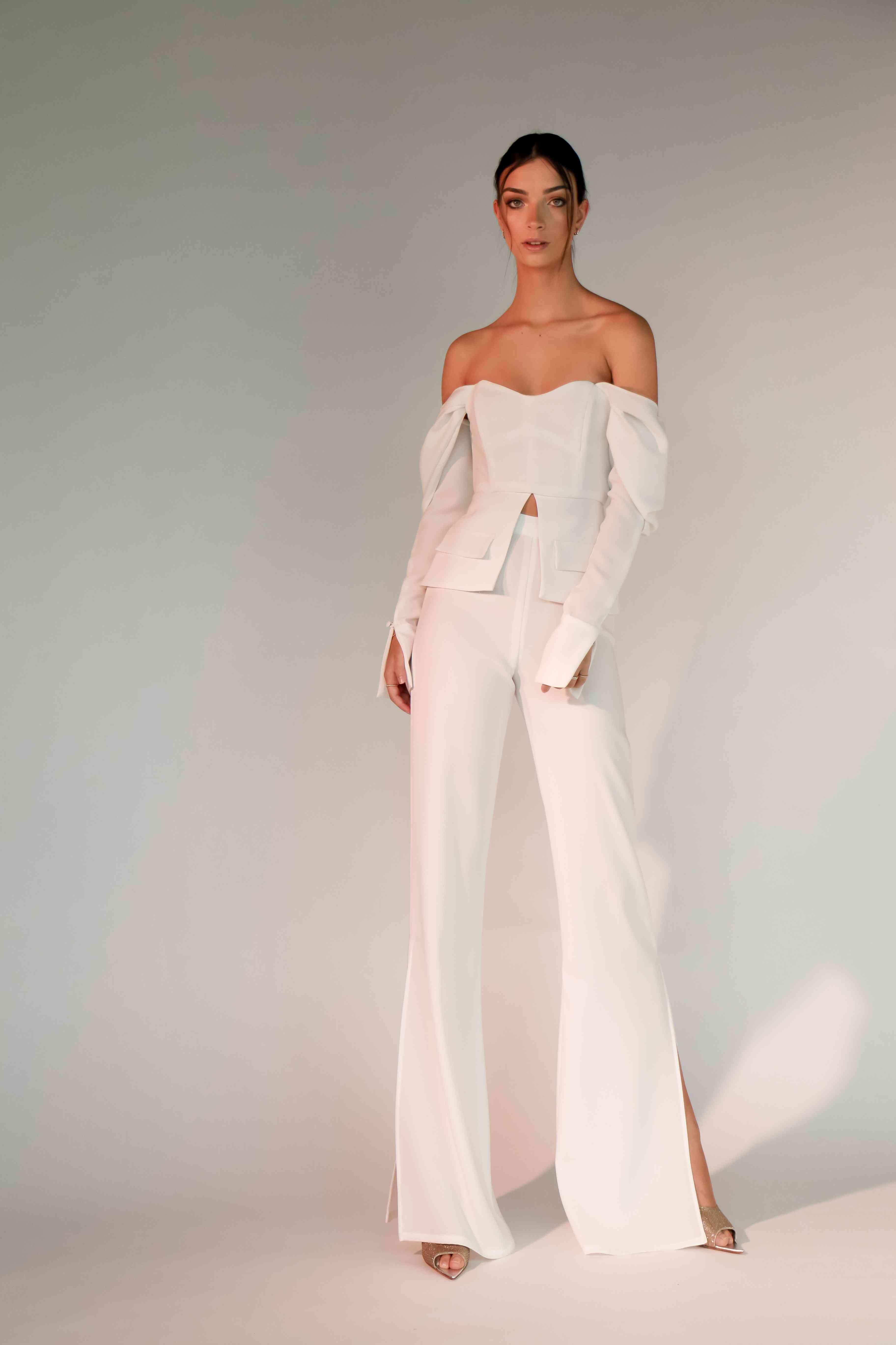 Bride wearing white suit