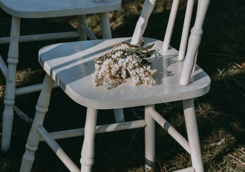 an empty chair with flowers