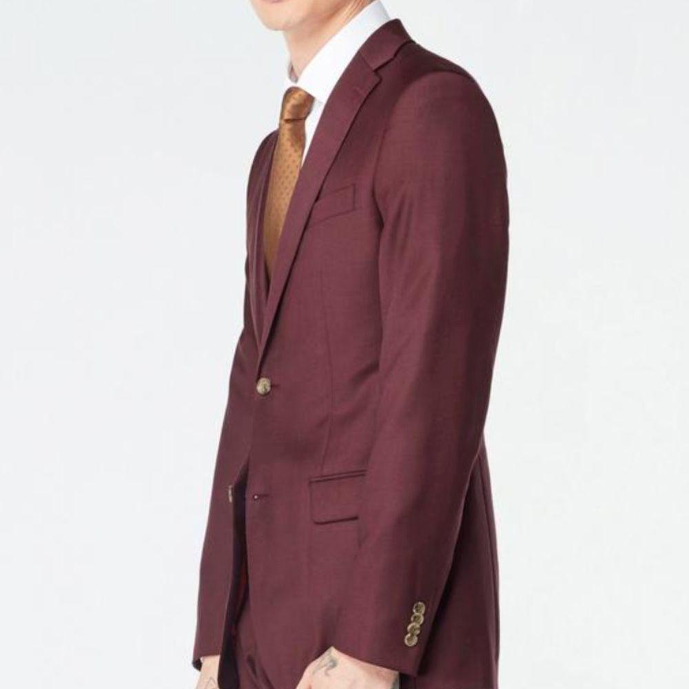 burgundy suit gold tie