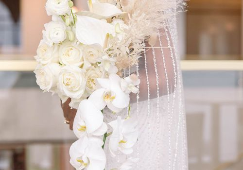 cascading white orchid bouquet
