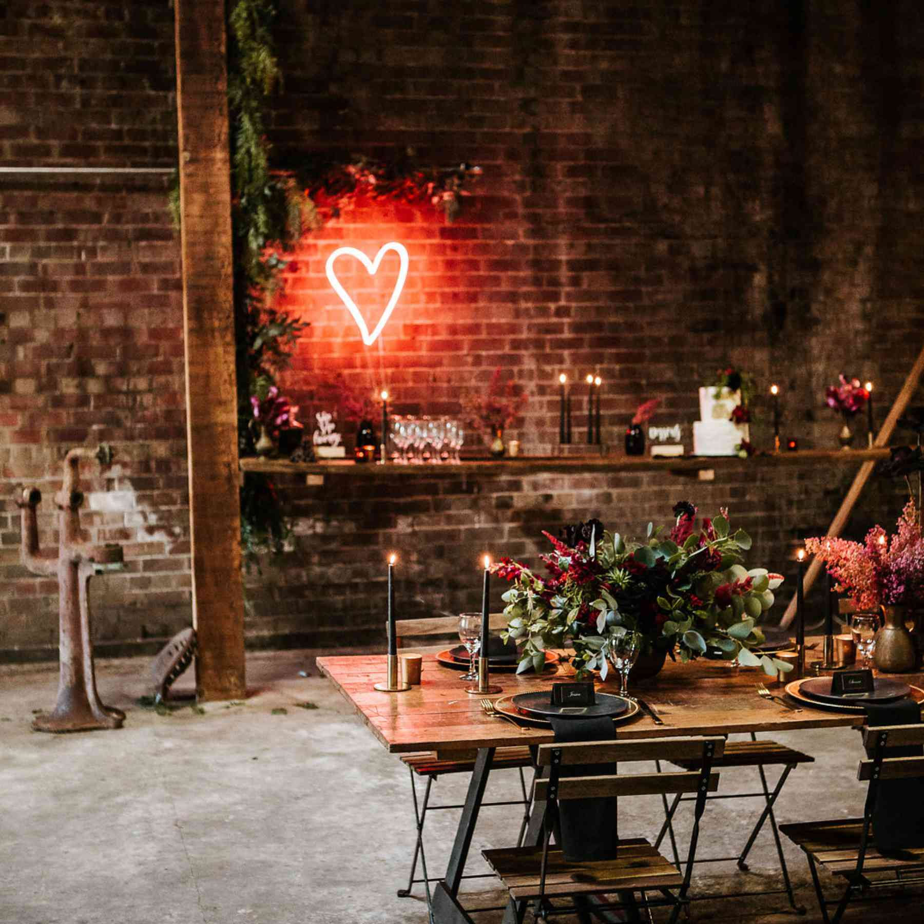 A red heart-shaped neon light in a dimly lit reception room