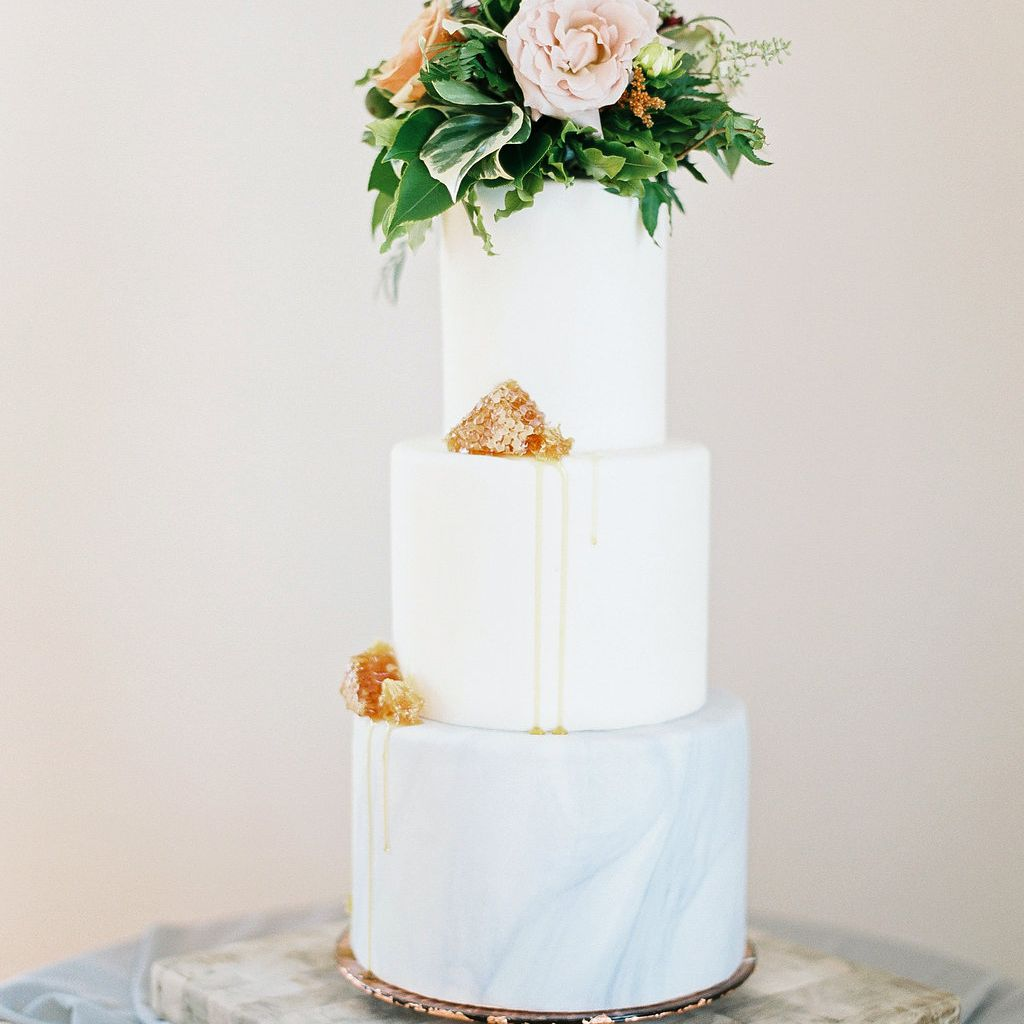 Three-Tiered White Wedding Cake with Candy Accents
