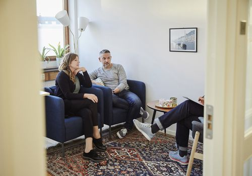Couple speaking with therapist