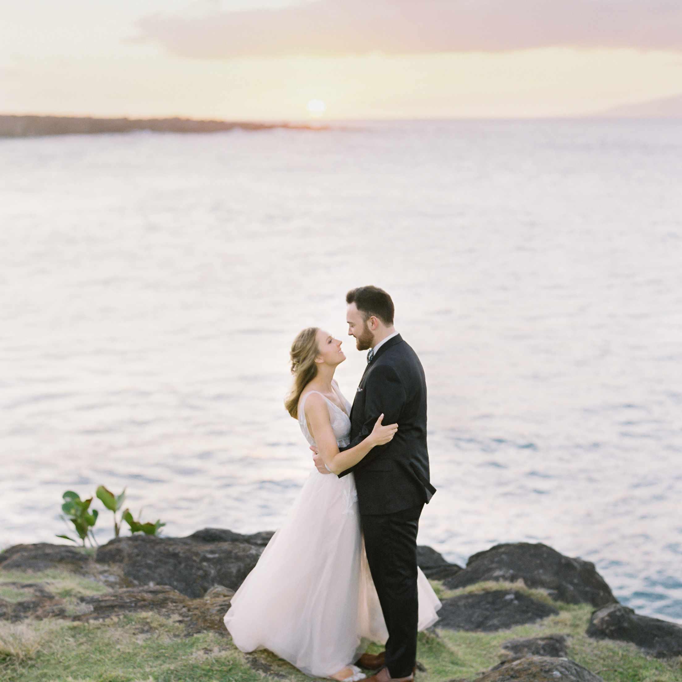 tropical maui wedding, bride and groom embracing sunset