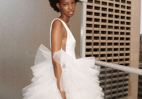 Model in wedding dress with layered tulle skirt