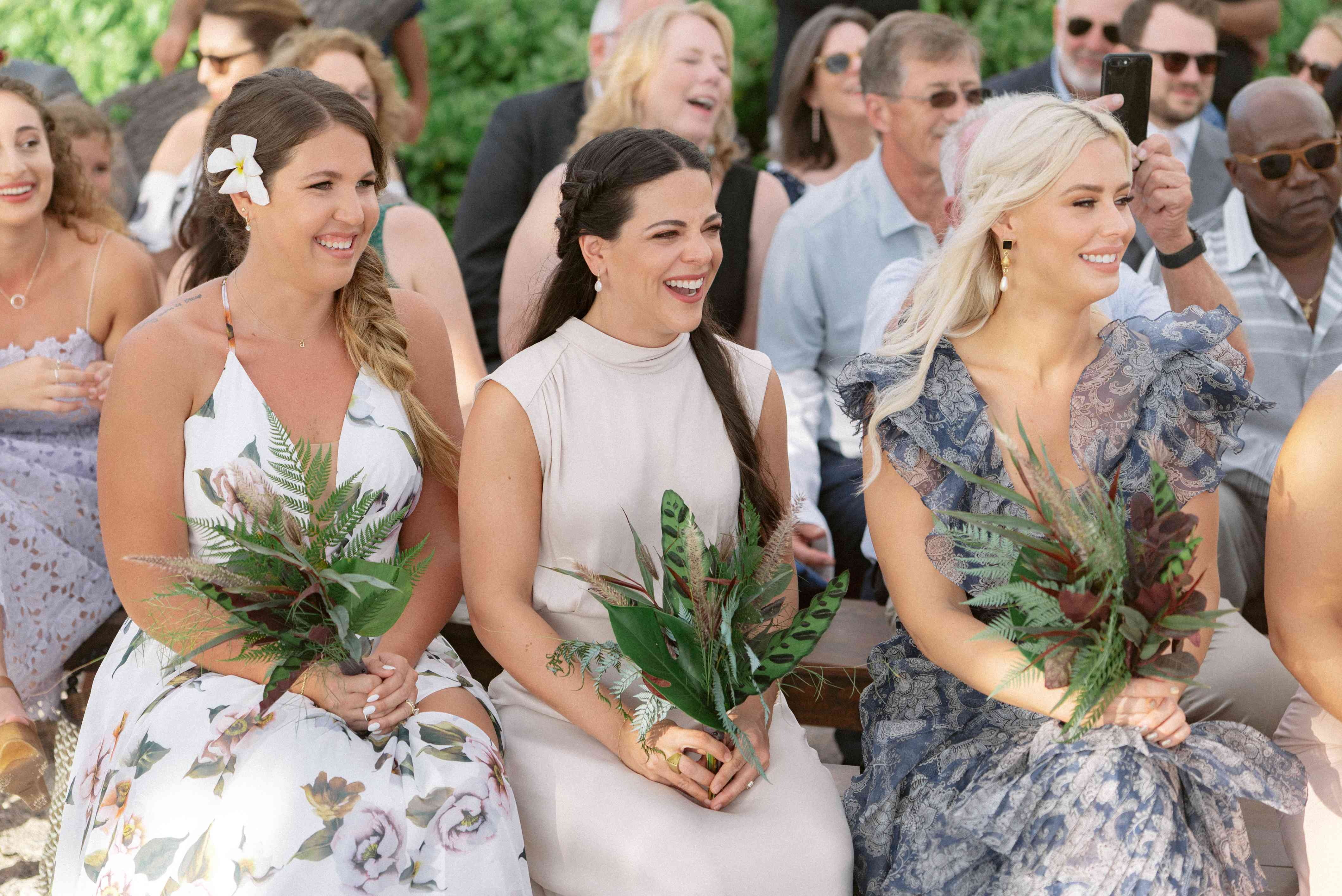 Bridesmaids share a laugh during the ceremony