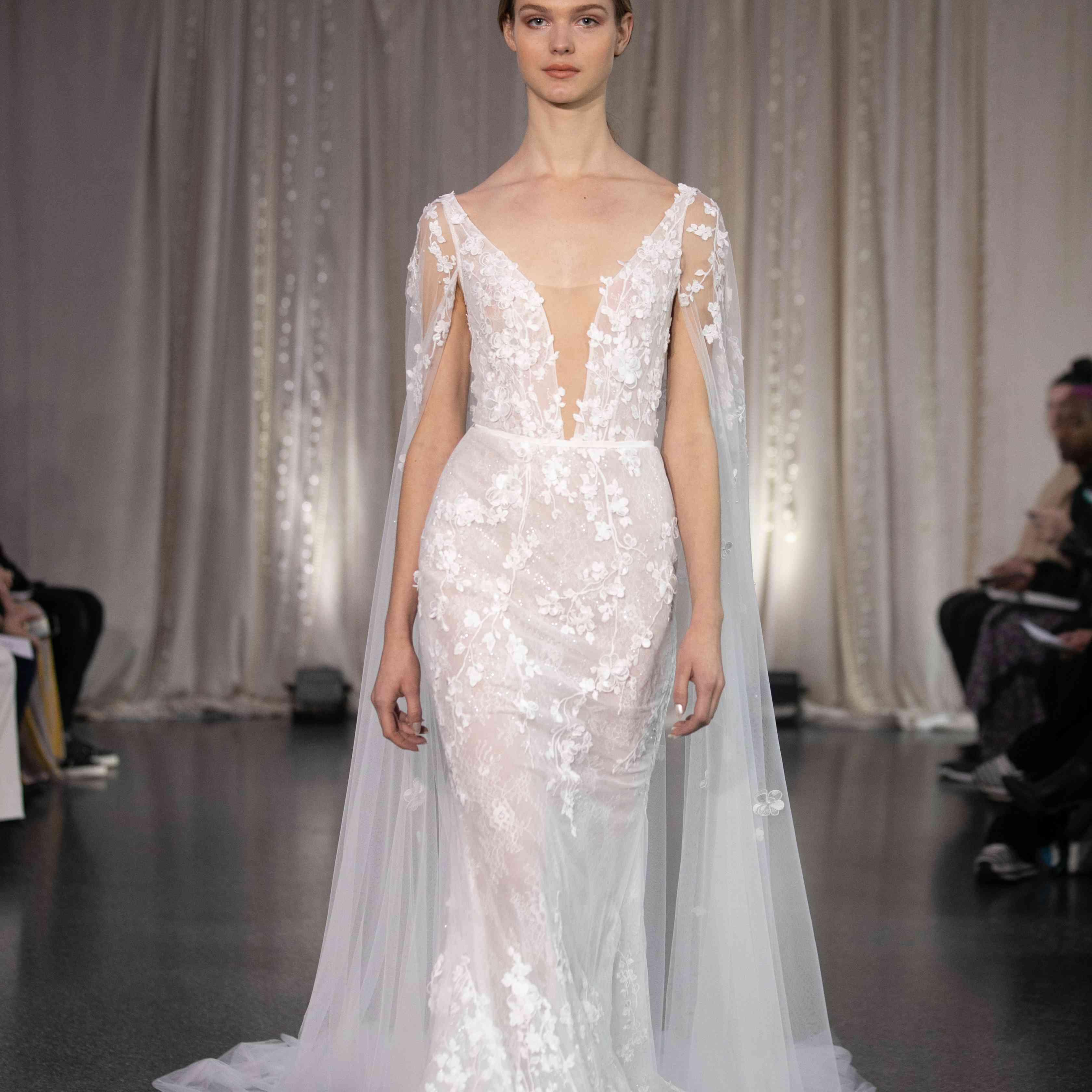 Model in plunging neckline mermaid wedding dress