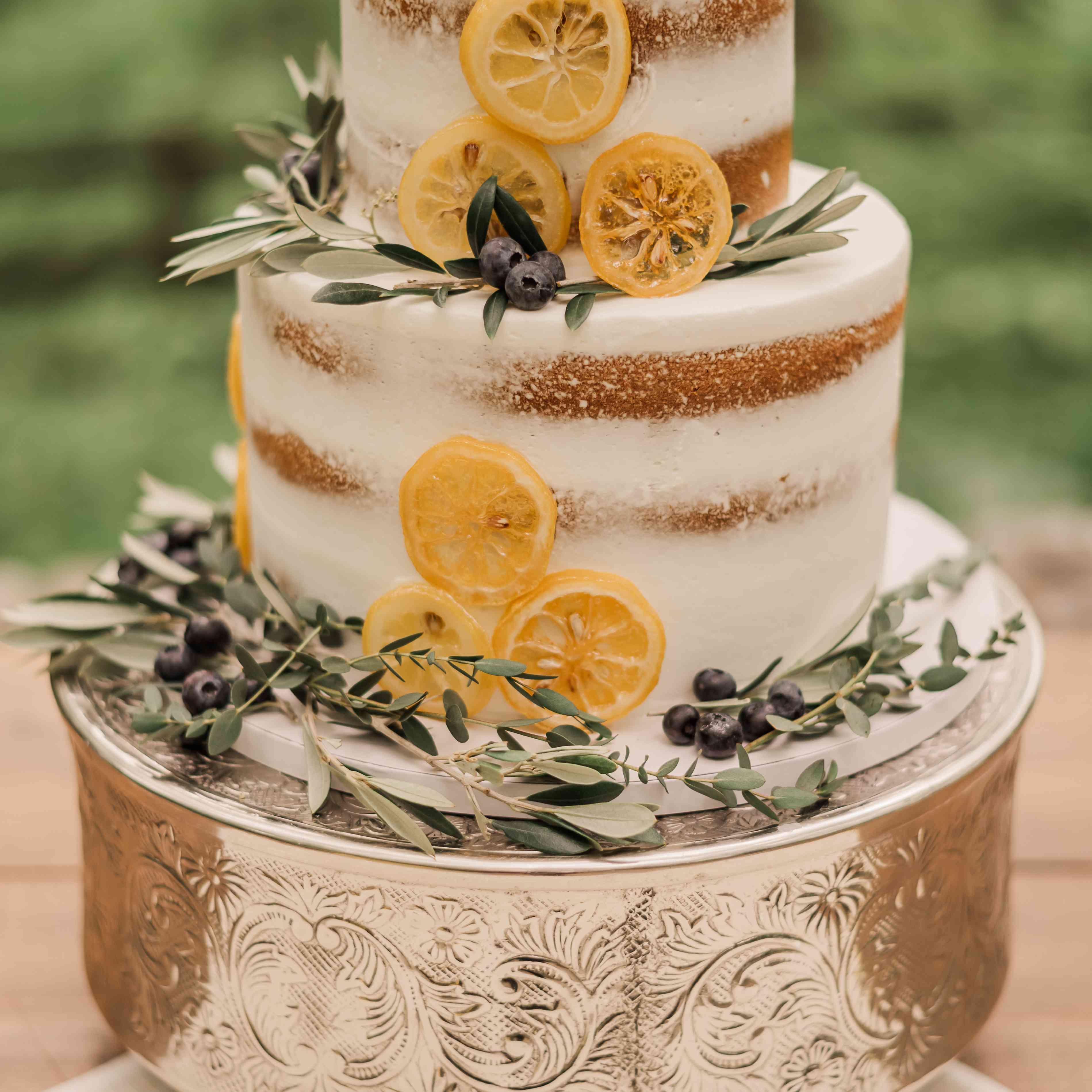 wedding cake with lemons and greenery