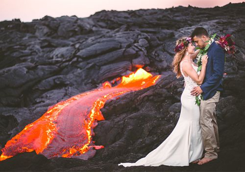 Bride and groom with hot lava in the background