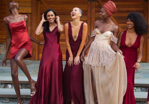 Bride having fun with bridesmaids.