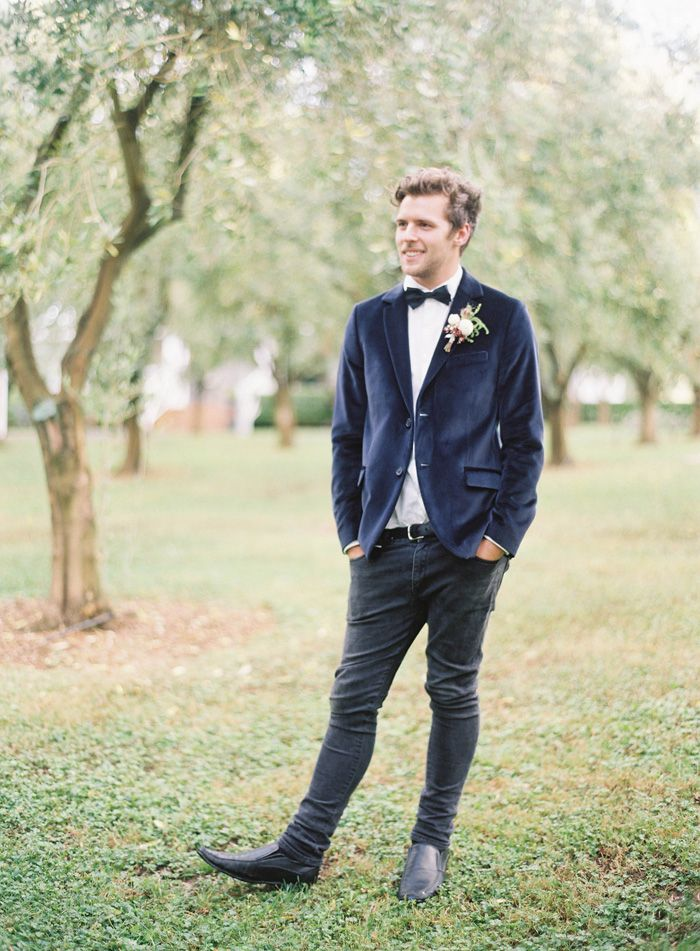 Groom in a navy suit and black pants